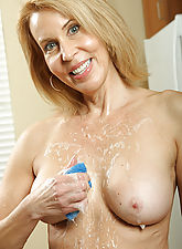 54 year old Erica from AllOver30 suds up her hairy pussy in these