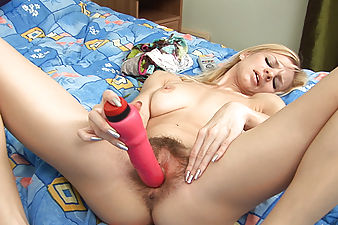 Sexy blonde natural Jessy drives her thick vibrator deep into her moist pink box. She is so tight she feels it pass every ridge of her hairy pussy.