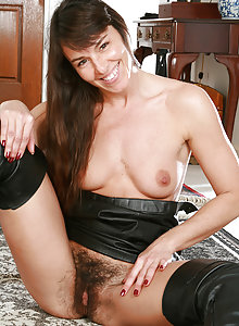 Long haired MILF show off her scary hairy pussy and spreads it