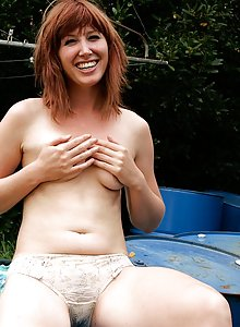 Beautiful Melodie stripping off outdoors