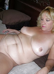 Fat German housewife posing nude
