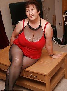 Fat grandma Kinky Carol showing curves in her black body stocking