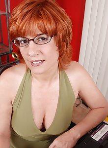 Red headed MILF strips off her clothes and spreads her mature pussy