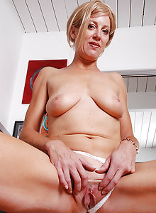 Blonde MILF Liz takes off her dress after finishing the days work