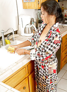 Tight asian housewife gets herself off at the kitchen sink