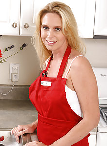 Debbie strips off her red apron and plays with her pussy