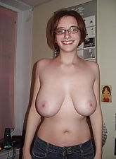 Nerdy girl with glasses and big natural boobs undressing