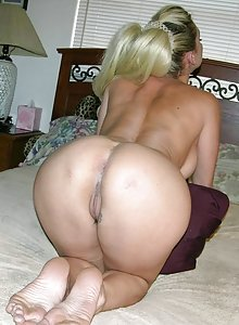 Hot blonde amateur housewife bends over and spreads her ass