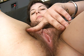Esther fucks her bush on the couch