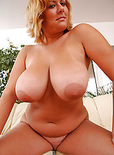 Big tits plumper Ellen showing off her juggs and shaved cunt