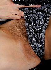 Hairy mature Hazel can't finish reading her paper without getting turned on. So she has a sip of tea and flaunts her amazing mature body and hairy pussy.