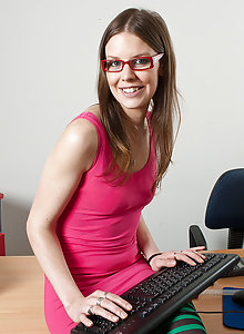 Geek Girl Charly is on the desktop in her glasses getting her aching pussy off