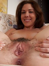 Katie Angel pulls on her long pussy hair