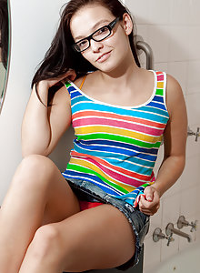 Petite young brunette in glasses