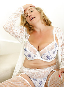 Busty over 50 mature babe Camilla A playing with her big boobs in stockings