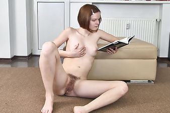 Hairy girl Denisma gets distracted while reading