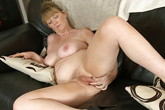 Sophie UK is sitting in her sexy school girl uniform when she decides to strip it off and rub down her hairy pussy. She slowly takes off her white top and plaid skirt before spreading her lips wide.