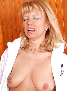 Horny blonde mom Merilyn fucks a younger guy and lets him cum on her belly