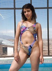 Christal takes off her swimsuit showing puffy nipples and unshaved squish