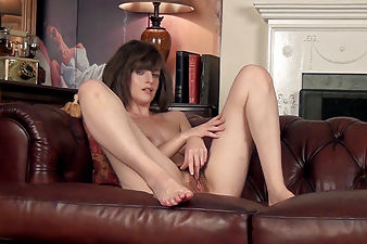 Finishing a call, Kate Anne strips naked for us