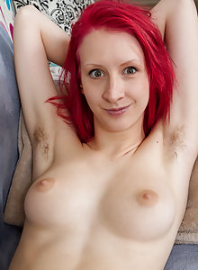 Red haired amateur Elizabeth M lets us view her all natural armpits and unshaved pussy