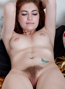 Red-head Sabrina does a little striptease for you