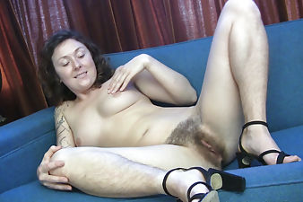 Luca spreads her hairy legs to give a nice view of her bush