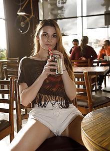 Leggy brunette amateur Lauralynn Parrish flashing her boobs in short shorts