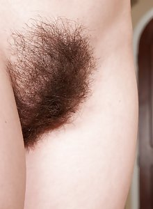Hairy redhead girl Annabelle Lee has her bush out while talking on the phone