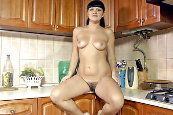Elicia plays with her hairy pussy after dishes