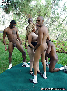 Blond bitch Holly gets fucked in all three fuckholes by black males with large dicks