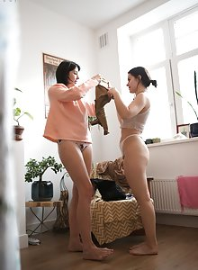 Unaware girls Daniela D and Amber caught dressing on camera