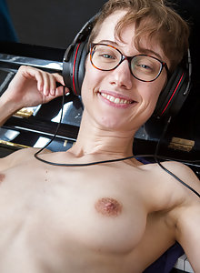 Nerdy glasses wearing Gretchen plays with her pussy fur at the piano