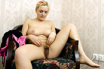 Lena loves to read dirty magazines. Whenever she sees those naked bodies she can't help but grab at her own hairy body, before stripping down and going all out on her hairy pussy.