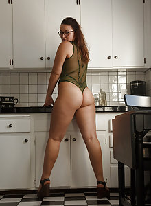 Healthy nerdy brunette amateur wearing glasses teasing in her lingerie