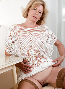 Hot over 50 blonde Diana V looks amazing in her stockings and garter