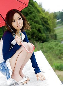 Cute Asian teen model in a mini skirt enjoys teasing the guys taking off clothes