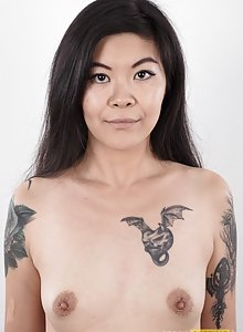 Tattooed Asian girl Irina came to us to shoot porn