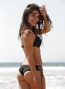 Cute petite babe Tiffany Drake flashing and teasing at the beach