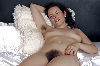 Lucia strips in bed and shows her hairy body
