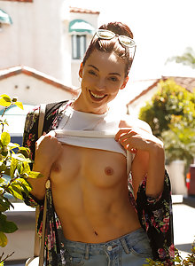 Pretty young brunette Ivah Anseline teases on the street and in her apartment