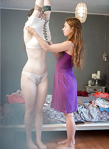 Real lesbians Emilia and Sophie caught getting dressed by voyeur