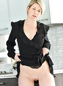 Curvy MILF Kit hikes up her skirt to show her hairless snatch