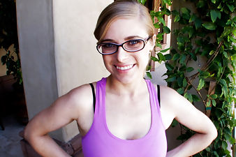 Penny Pax wearing glasses and giving a handjob