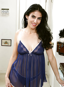 Sultry Latina MILF Veronica Perez takes off her lingerie to pose barefoot and spread wide