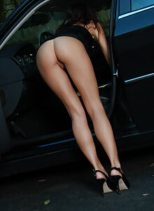 Gorgeous long legged brunette honey Destiny Moody bends over in her hiked up dress showing her perfect ass