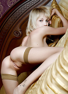 Platinum blonde beauty Milana B flaunts her sexy body on the bed