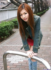Naughty Japanese tramp lies back showing her thigh highs and her thong panties