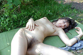 Kirina masturbates and plays with her pussy outside