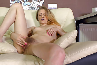 Fani playing with her hairy pussy on the couch